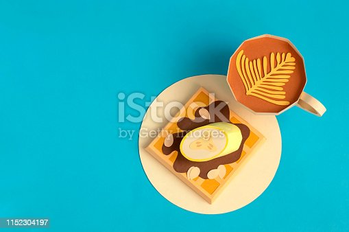 istock Belgian waffles with chocolate and banana, cup of cappuccino made of paper 1152304197