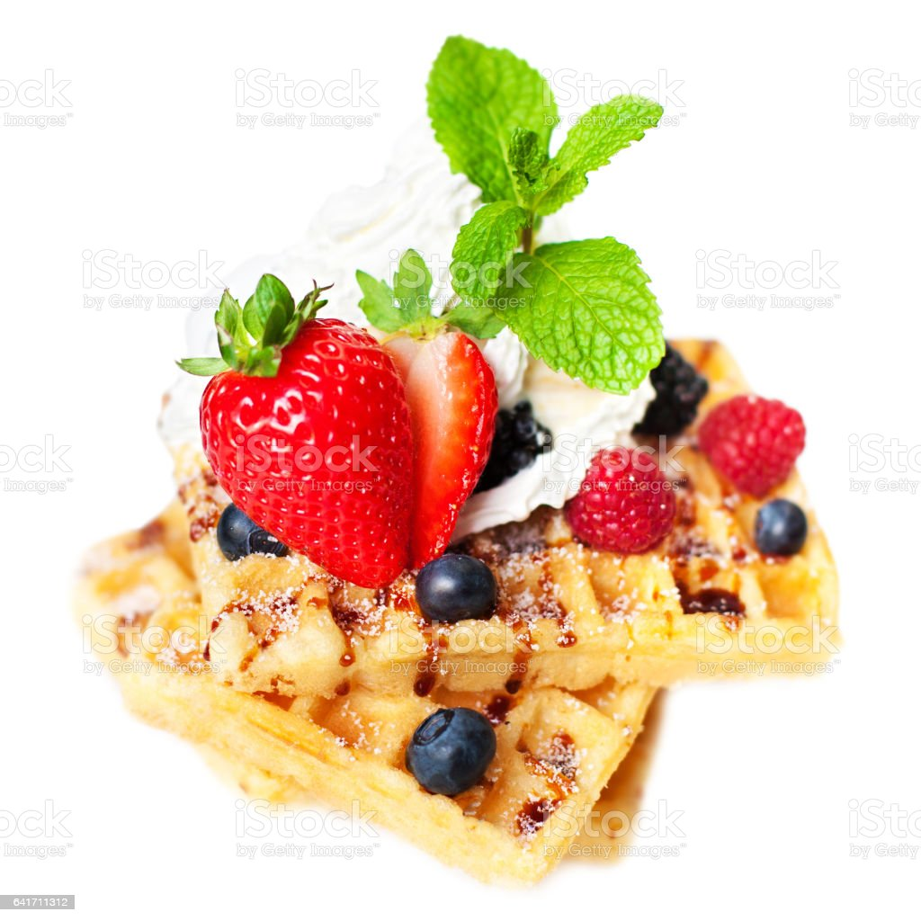 Belgian waffles with fresh berries isolated on white background stock photo