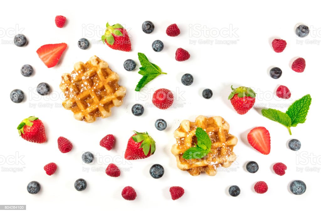 Belgian waffles with fresh fruit, mint leaves, and copyspace stock photo