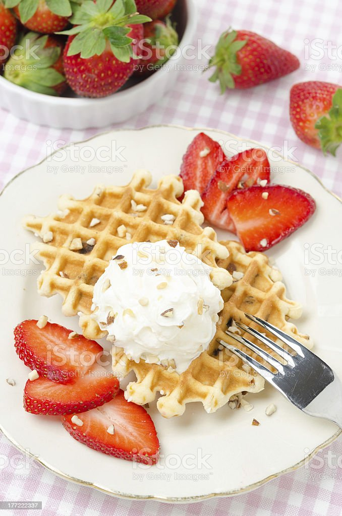 Belgian waffles with fresh strawberries and whipped cream royalty-free stock photo