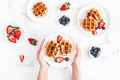 istock Belgian waffles with fresh strawberry blueberry. Flat lay, top view 926836204