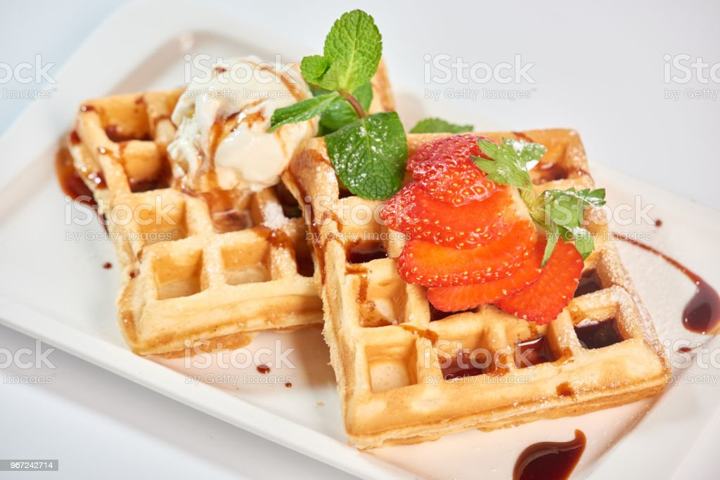 Belgian waffles with strawberries. stock photo