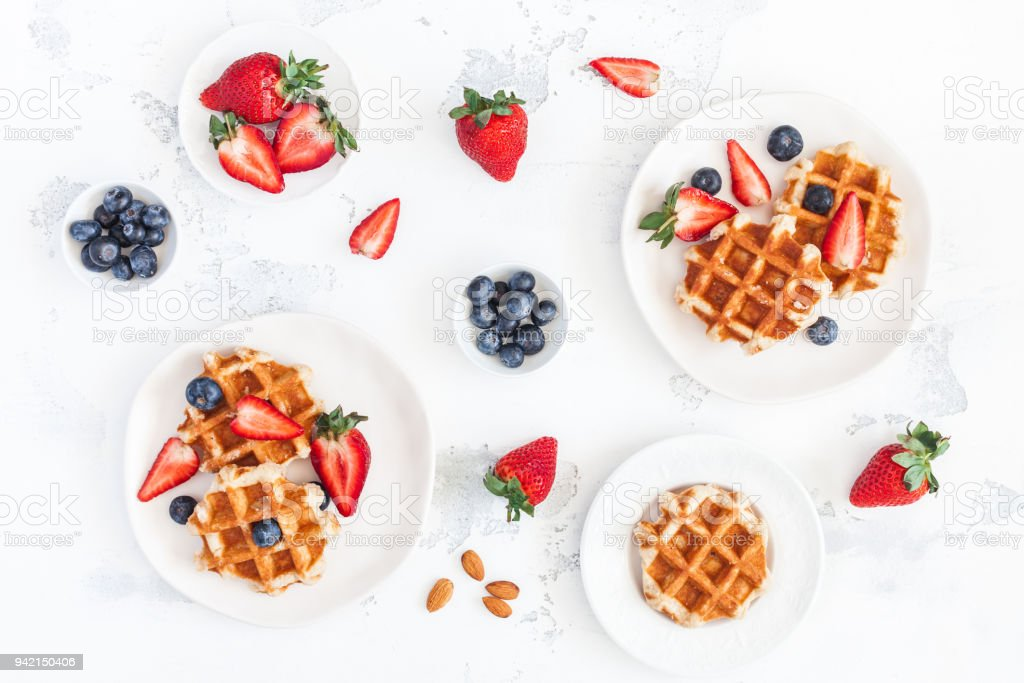 Belgian waffles with strawberry and blueberry. Flat lay, top view stock photo