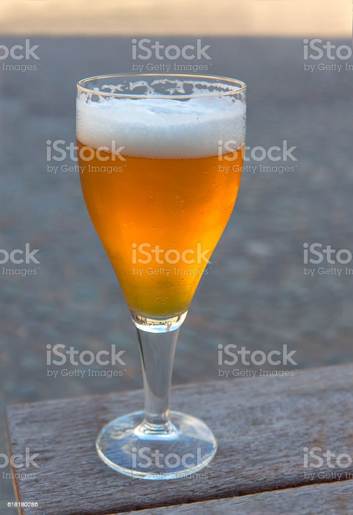 belgian white beer in cold glass at brugge belgium stock photo