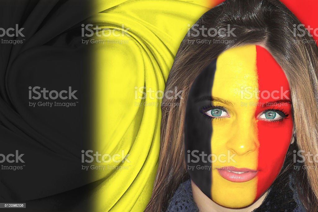 Belgian woman in front of flag stock photo