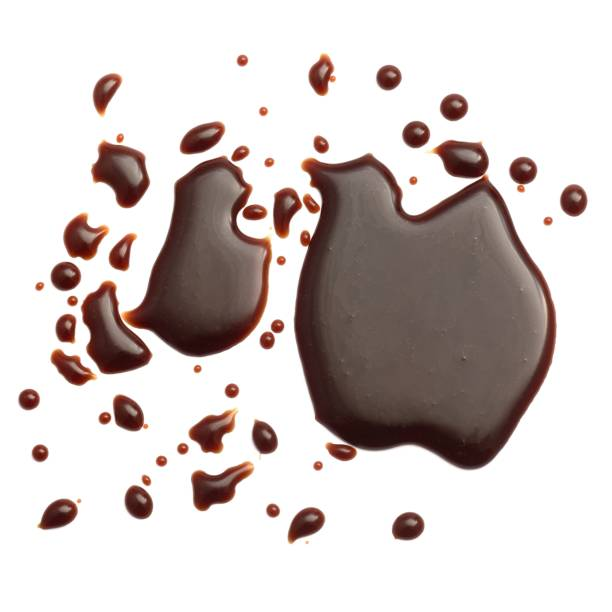 belgium chocolate sauce droplets - chocolate syrup stock photos and pictures