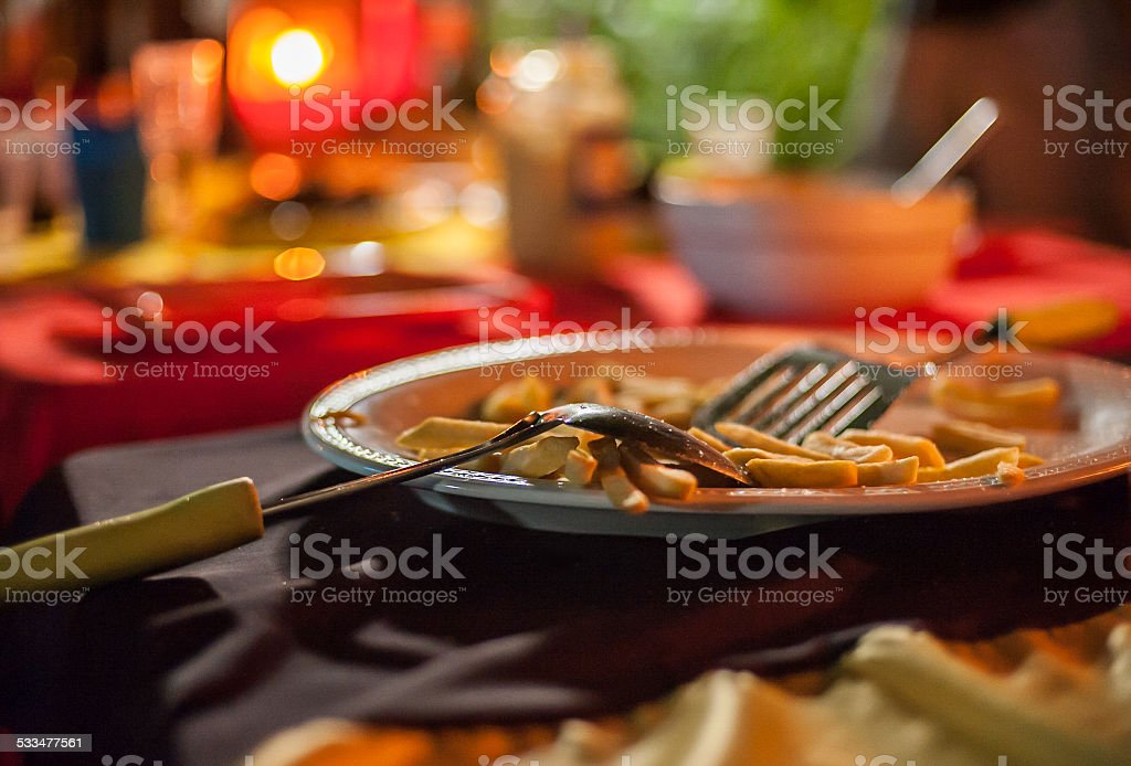 Belgium fries served at a party at night stock photo
