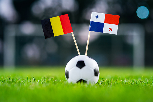 Belgium - Panama, Group G, Monday, 18. June, Football, World Cup, Russia 2018, National Flags on green grass, white football ball on ground.
