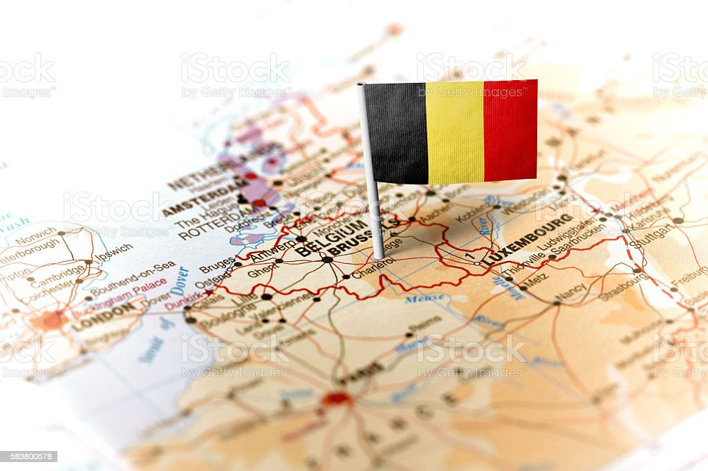 Belgium pinned on the map with flag stock photo