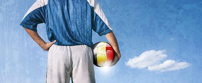 istock Belgium soccer player holding ball with belgian flag 923476478