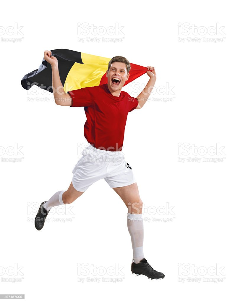 Belgium soccer player runs with flag after victory foto