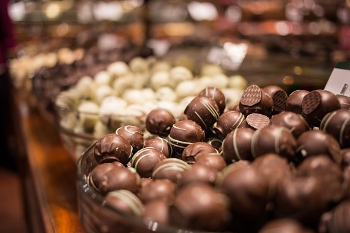 Belgium tasty truffle delicious chocolate in a row, candy shop view. Food travel tourism