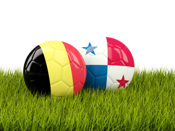 Belgium vs Panama. Soccer concept. Footballs with flags on green grass stock photo