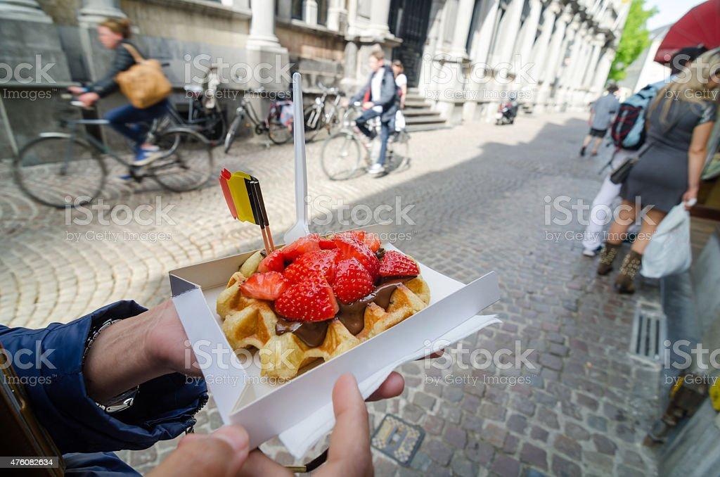 Belgium waffle with chocolate sauce and strawberries stock photo