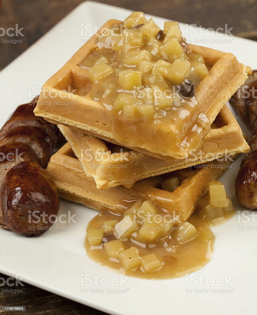 Belgium waffles with apple sauce and sausage royalty-free stock photo
