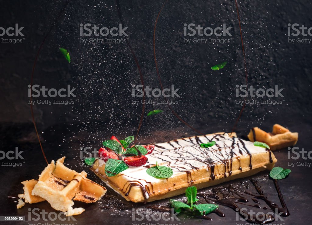 Belgium waffles with chocolate sauce, ice cream and strawberries isolated on black background - Royalty-free Backgrounds Stock Photo