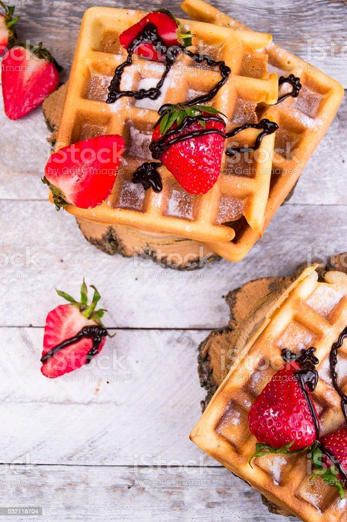 Belgium waffles with strawberries and chocolate stock photo
