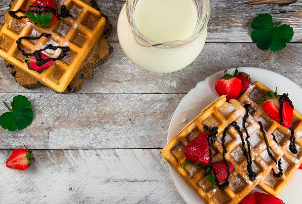 Belgium waffles with strawberries and chocolate. Top view stock photo