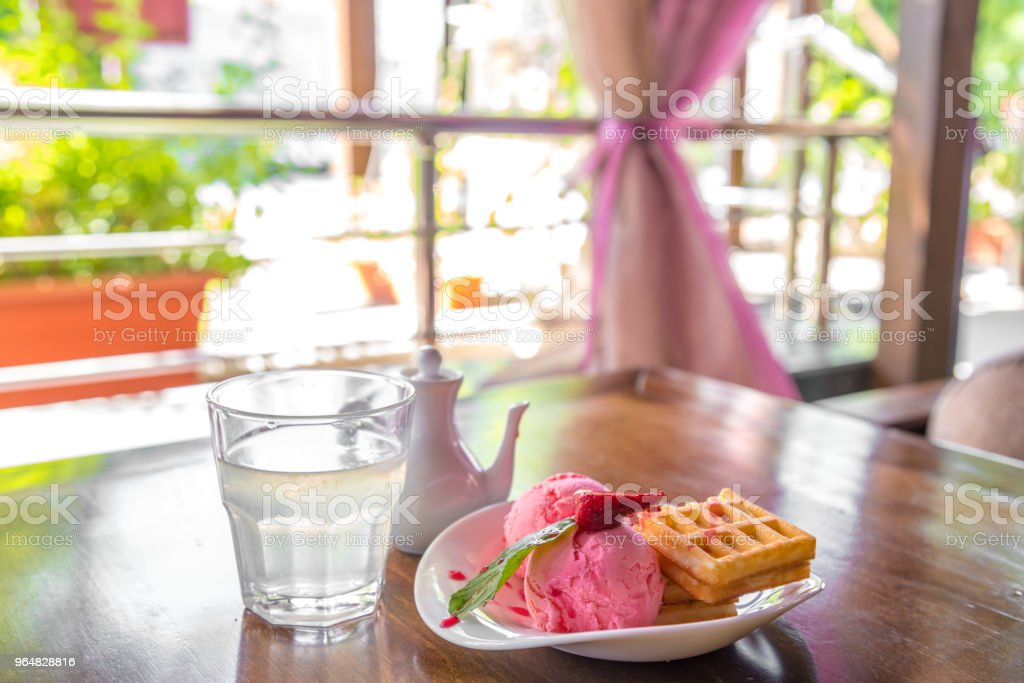 Belgium waffles with strawberries and ice cream on white table in on the summer veranda royalty-free stock photo