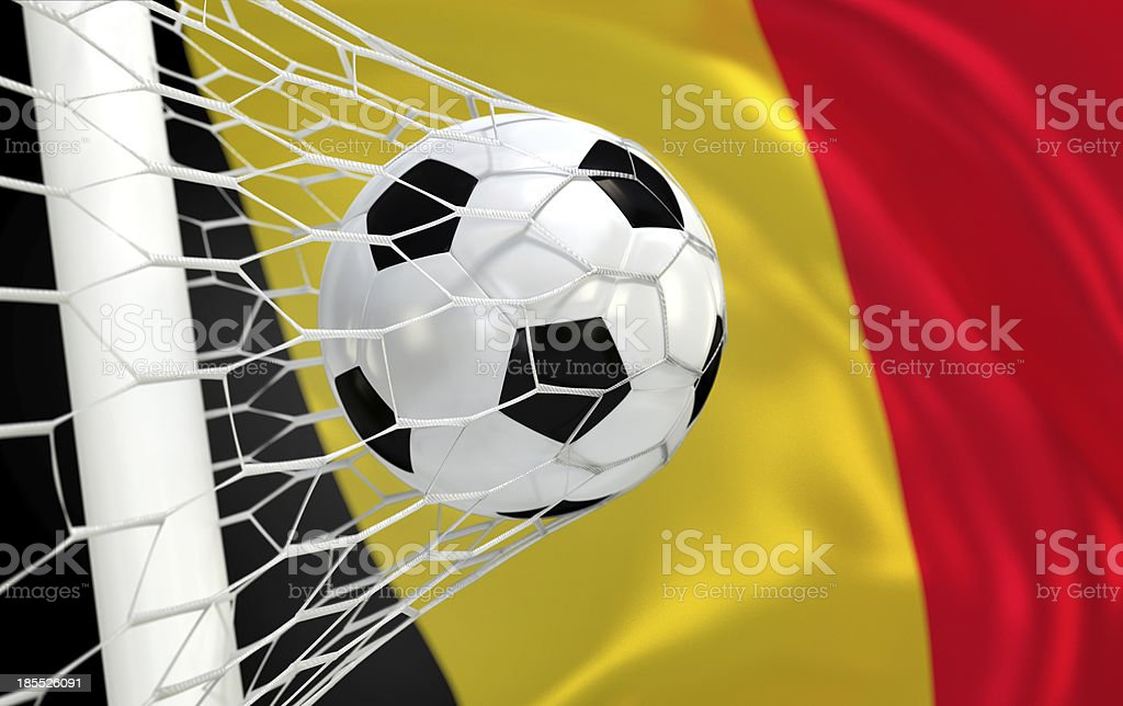 Belgium waving flag and soccer ball in goal net stock photo