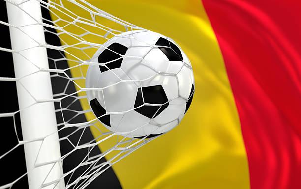 Belgium waving flag and soccer ball in goal net stock photo