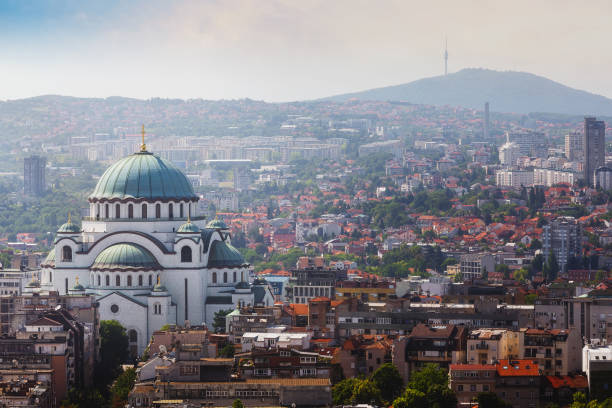 Belgrade downtown skyline with temple of Saint Sava and Avala tower Aerial view of old Belgrade, capital of Serbia with St. Sava temple and Avala tower in the background serbia stock pictures, royalty-free photos & images