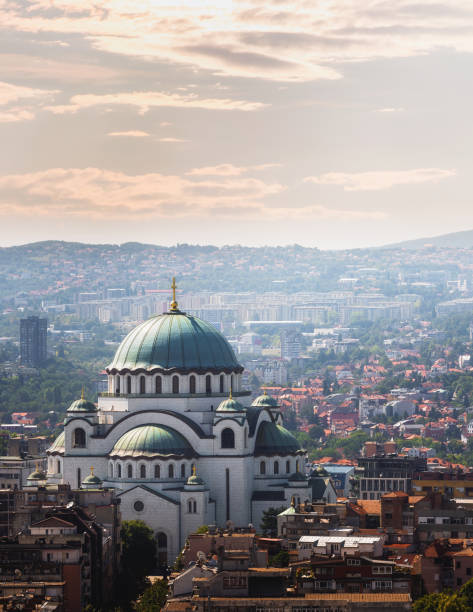 belgrade downtown skyline with temple of saint sava - belgrade serbia stock photos and pictures