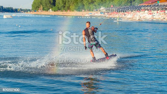 A cable powered wakeboarding park at Lake Ada Ciganlija. A young wakeboarder is riding his board on a popular lake in Belgrade, Serbia.