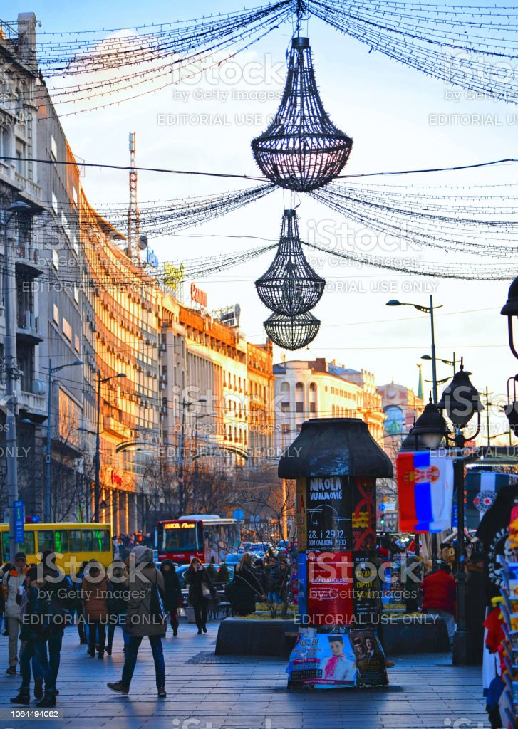 Belgrade, Serbia street full of people and shops in old town decoration and illuminated for New Year and Christmas stock photo
