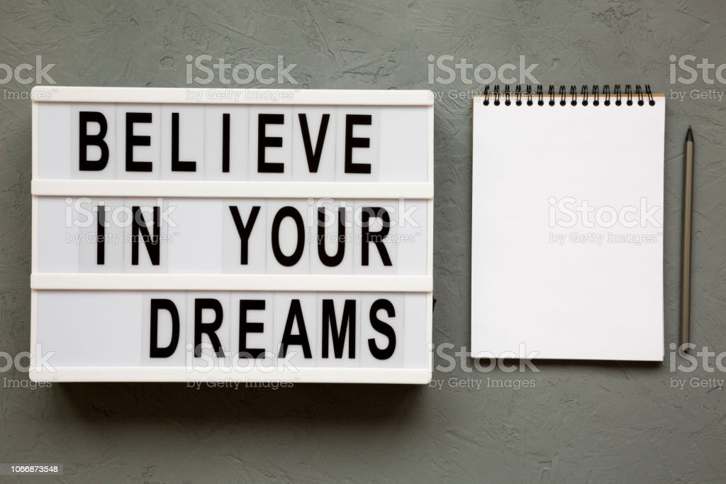 Believe In Your Dreams Word On Modern Board Notepad Over