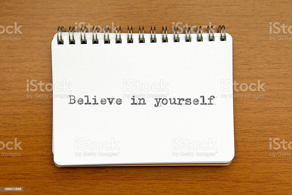 Believe in yourself: motivational quote on note pad stock photo