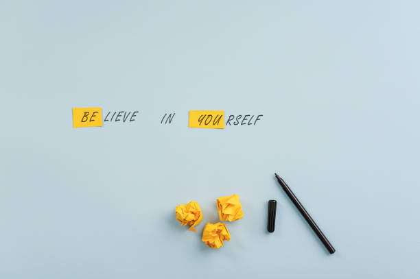 Believe in yourself note stock photo