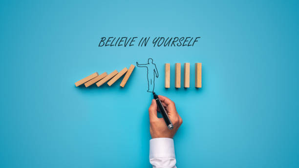 Believe in yourself sign stock photo