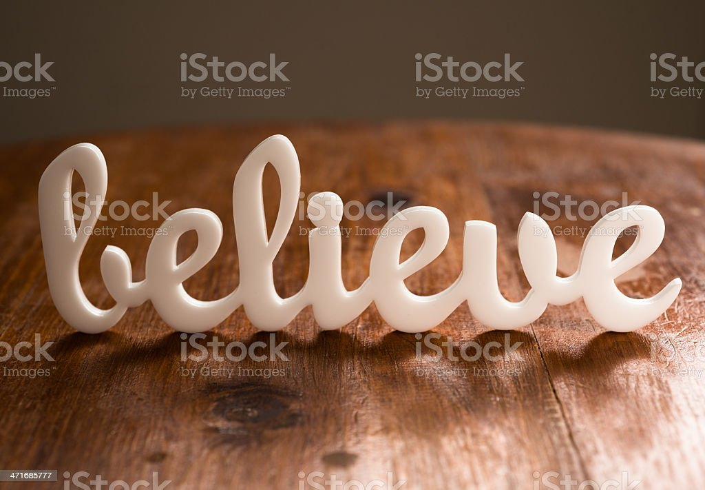 Believe on Wooden Table royalty-free stock photo