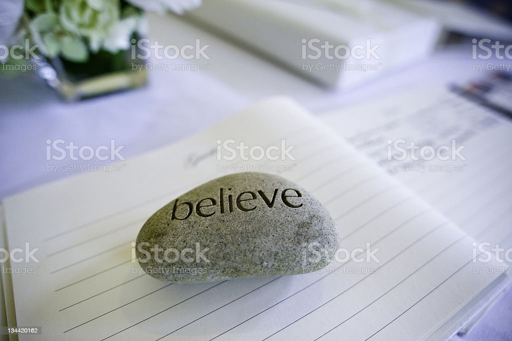 Believe Rock Paper Weight on Guest book stock photo