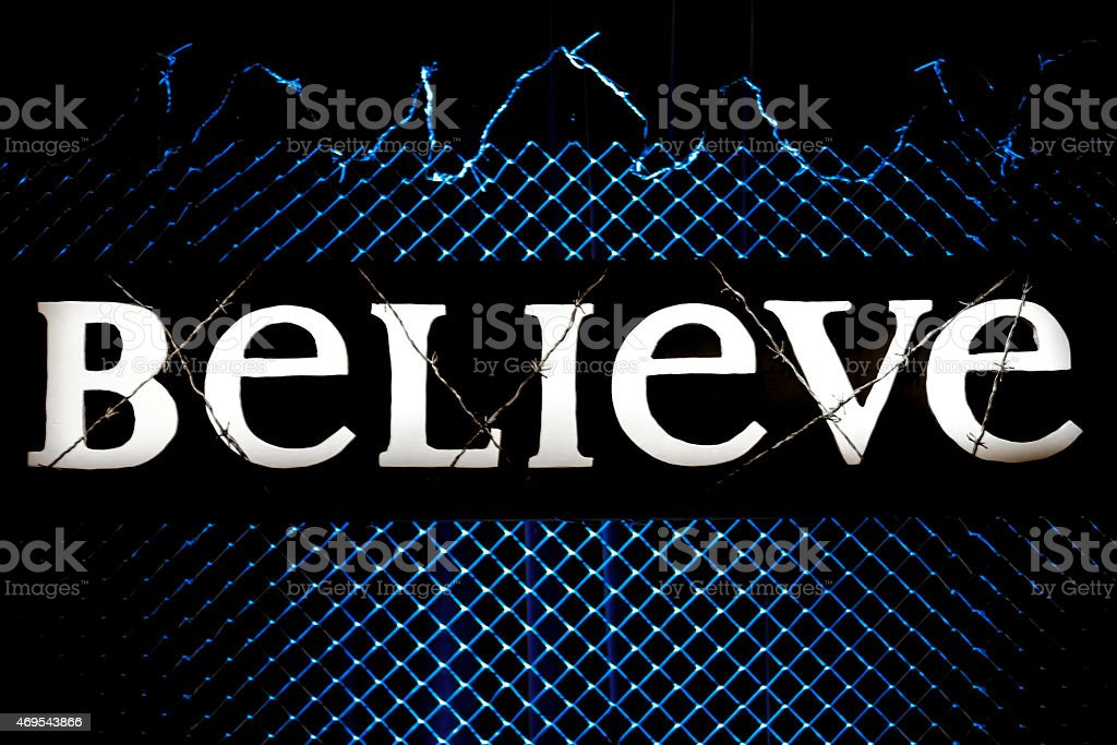 Believe Sign Covered In Barbed Wire stock photo