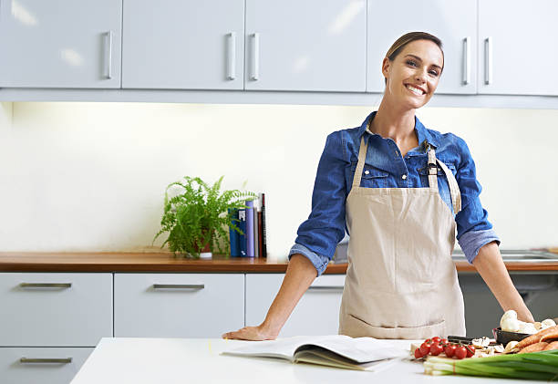 i believe that a home-cooked meal is best - apron stock pictures, royalty-free photos & images