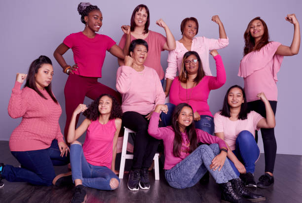 Believe you can and you can! Studio shot of a group of diverse women wearing pink clothing against a purple background women's rights stock pictures, royalty-free photos & images