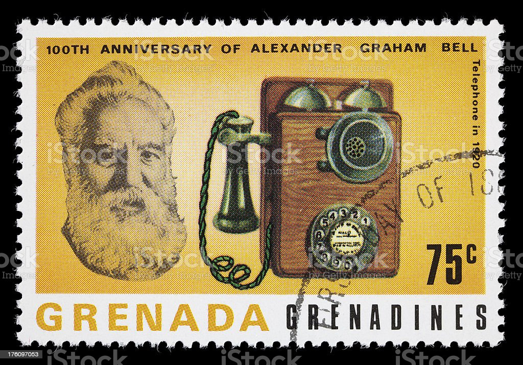 Bell and 1920 telephone postage stamp stock photo