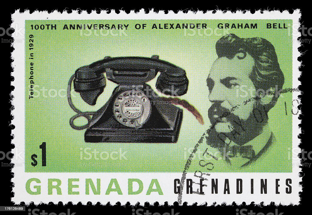 Bell and 1929 telephone postage stamp stock photo