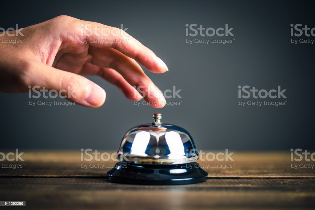 Bell and businessman's hand stock photo