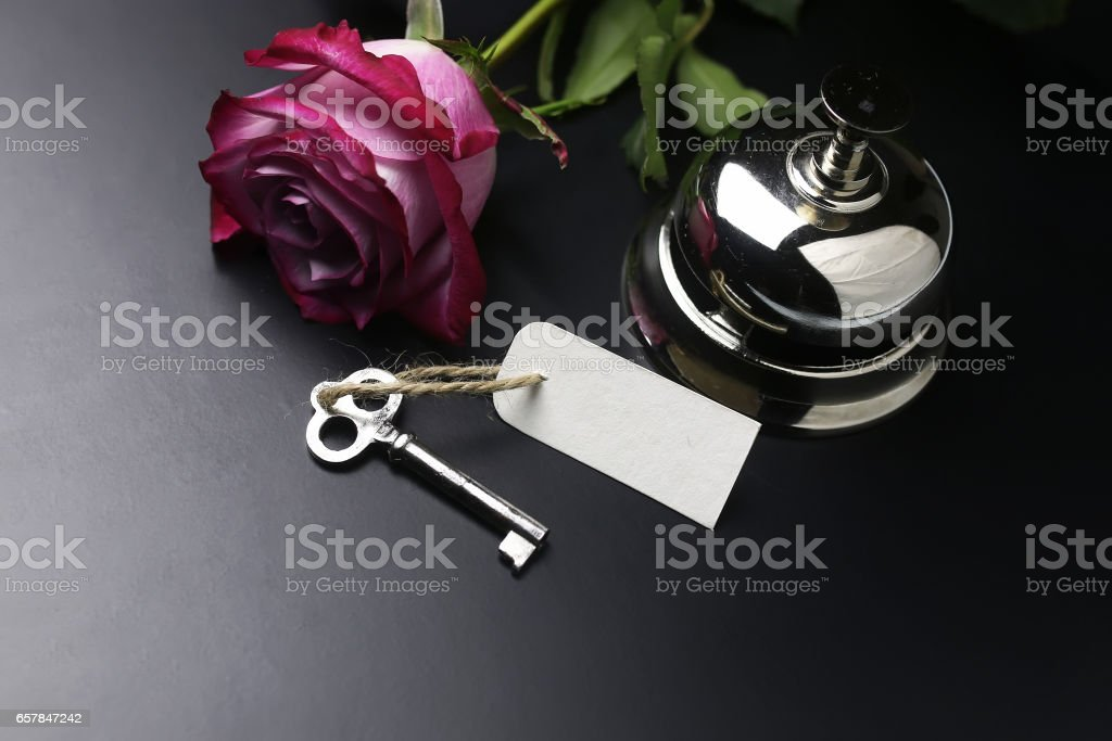 bell and the key at the reception in the hotel stock photo