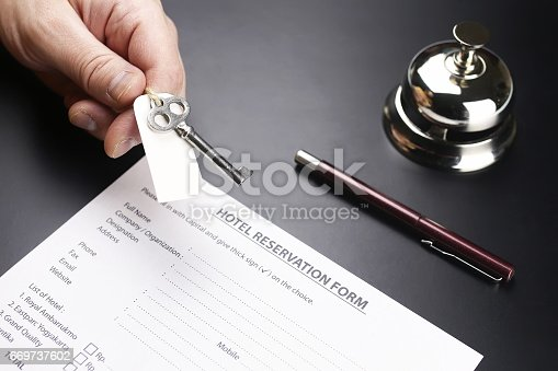 istock bell and the key at the reception in the hotel 669737602