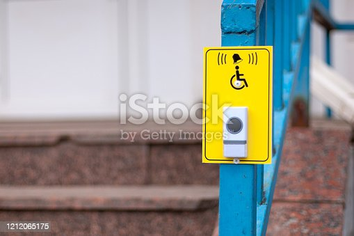 Yellow bell button and  disabled sign for wheelchair pharmacy customers