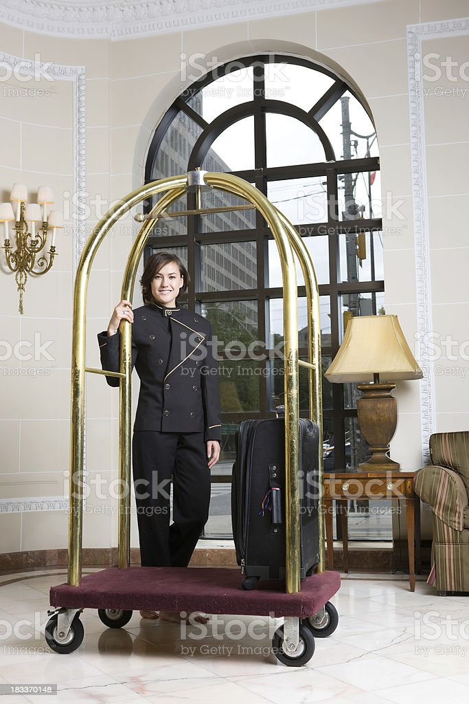 Bell Hop Stands With Cart In Luxury Hotel stock photo