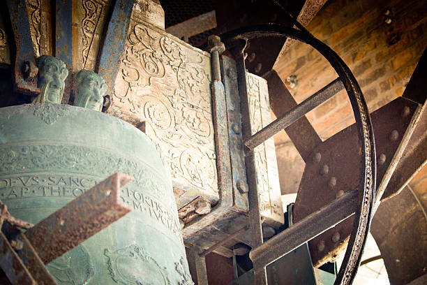 Bell in the Camponile in Venice Venice, Italy - April 11, 2015: A huge bell with latin inscription and its support structure in the belltower or Camponile in Venice's San Marco Piazza. galileo galilei stock pictures, royalty-free photos & images