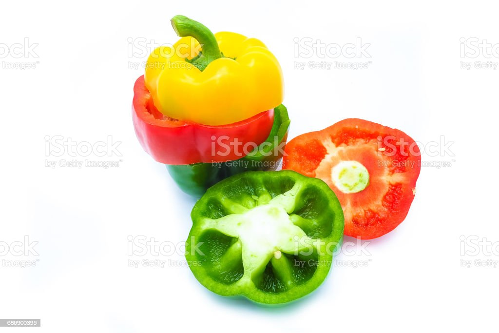 Bell pepper is sliced in three colors, isolated on a white background stock photo