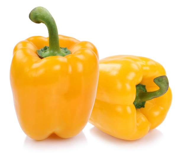 Bell pepper peppers paprika paprikas yellow vegetable isolated on white Bell pepper peppers paprika paprikas yellow vegetable isolated on a white background yellow bell pepper stock pictures, royalty-free photos & images