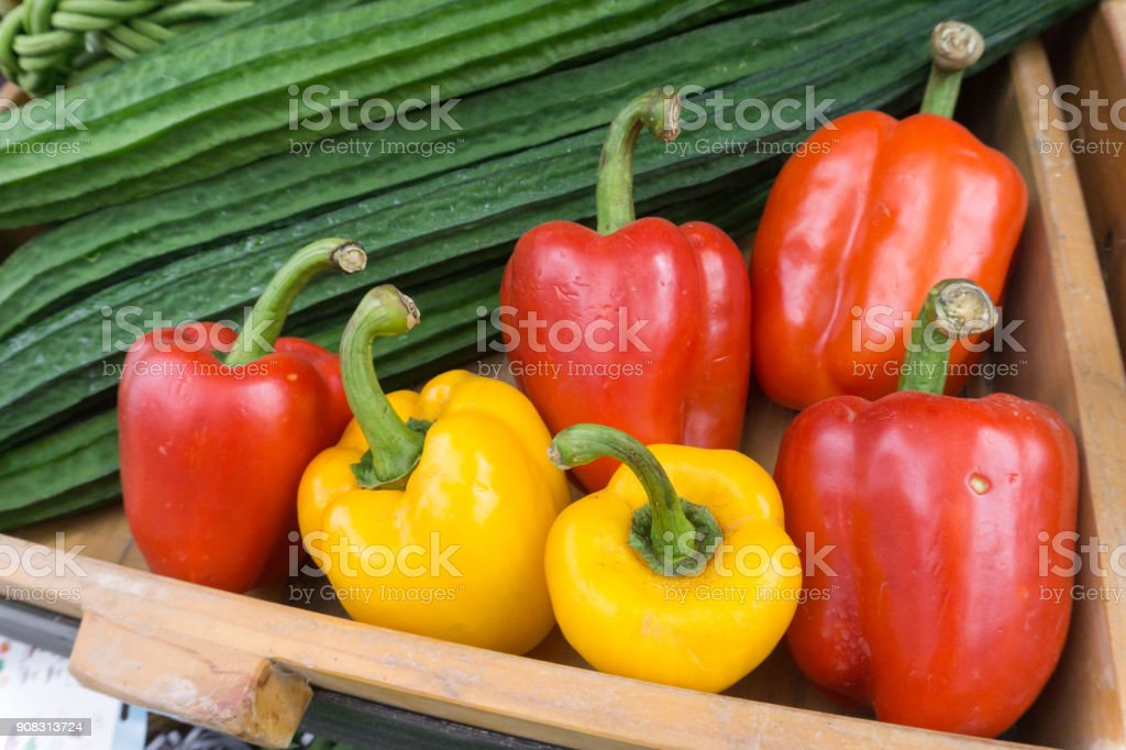 Bell Peppers and Luffa acutangula at local market stock photo