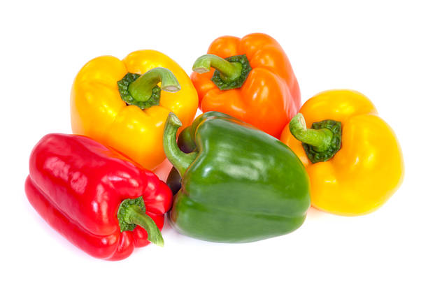 Bell Peppers Group of  bell peppers isolated on white background. Green, yellow, red and orange colors. yellow bell pepper stock pictures, royalty-free photos & images